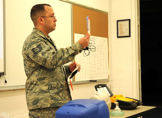 U.S. Air Force Tech. Sgt. Jason Miller, 27th Special Operations Maintenance Operations Squadron, explains components of an Automated External Defibrillator to his class in a training detachment at Cannon Air Force Base, N.M., Feb. 8, 2012. The CPR course provided is through the American Heart Association and is required by the 27th Special Operations Maintenance Group every two years. (U.S. Air Force photo by Airman 1st Class Alexxis Pons Abascal)