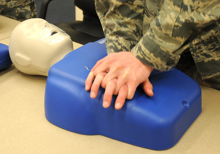U.S. Air Force Airman 1st Class Jason Brooks, 27th Special Operations Equipment Maintenance Squadron, practices chest compressions on his CPR dummy in a training detachment at Cannon Air Force Base, N.M., Feb. 8, 2012. The CPR course provided is through the American Heart Association and is required by the 27th Special Operations Maintenance Group every two years. (U.S. Air Force photo by Airman 1st Class Alexxis Pons Abascal)