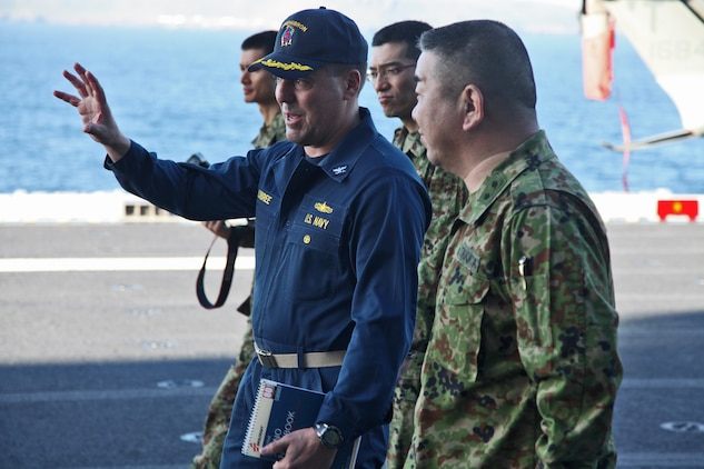 Navy Capt. Shawn Lobree, deputy commander, Amphibious Squadron 3, shows Major General Katsuki Takata, deputy chief of staff for operations, Western Army, the flight deck of the USS Peleliu, Feb. 10. Marines and sailors with the 15th Marine Expeditionary Unit, and soldiers with the Japanese Ground Self Defense Force, are participating in a week-long at-sea period during Exercise Iron Fist 2012.  The exercise encompasses all aspects of the Marine Air Ground Task Force during the training on San Clemente Island and provides the Navy/Marine Corps team an opportunity to practice its craft. Exercise Iron Fist 2012 is a bilateral training exercise, which gives the 15th MEU a chance to demonstrate its amphibious capabilities to the Japanese.