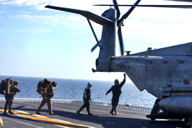 Marines and sailors from 3rd Amphibious Assault Battalion, 1st Marine Division, file into a CH-53E helicopter on the flight deck of the USS Peleliu, Feb. 10. The servicemembers were bound for San Clemente Island for the culminating training event of Exercise Iron Fist 2012, a bilateral training event between the 15th Marine Expeditionary Unit and the Japanese Ground Self Defense Force and encompasses all aspects of the Marine Air Ground Task Force.