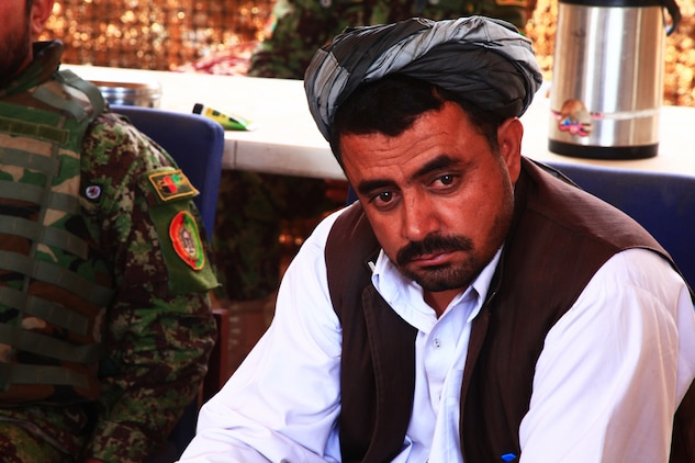 The district governor of Washir district, Helmand province, Daoud Mohammad, listens to others during a shura, which is an Afghan meeting, in Shorab City, August 19. During the shura local men, Afghan National Army soldiers and government officials discussed security and legal issues in the area.
