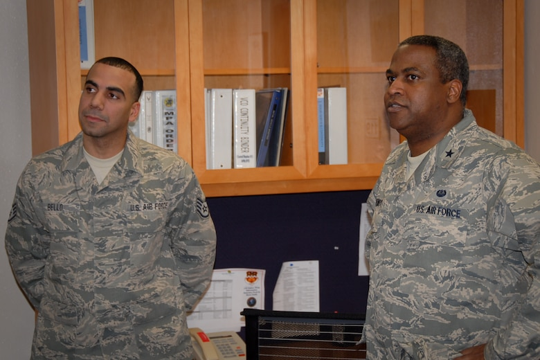 Brig. Gen. Brian C. Newby, chief of staff for the Texas Air National Guard, visits with Staff Sgt. Edwin Bello, a member of the 149th Fighter Wing, also known as the Lone Star Gunfighters, at Lackland Air Force Base, Texas, during the unit training assembly, or UTA, Feb. 11, 2012. (National Guard photo by Staff Sgt. Phil Fountain / Released)