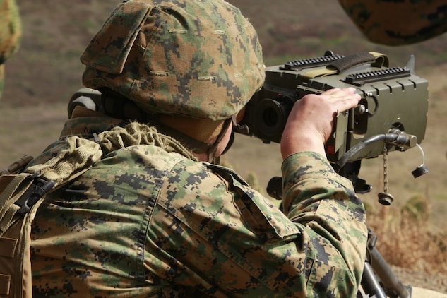 A Marine with 1st Air Naval Gunfire Liaison Company looks through a Portable Lightweight Designator Range finder during a combined arms exercise with the Japanese Ground Self Defense Force, Feb. 12. The PLDR is used is laser guided and is used to help place a bomb in a specific area. The exercise included 81 and 120mm mortars, fixed and rotary wing assets and Naval gun fire.  In addition to the gunfire exercise, the Japanese also practiced calling for fire. Exercise Iron Fist 2012 is a bilateral training exercise that gave the 15th MEU a chance to demonstrate its amphibious capabilities to the Japanese.