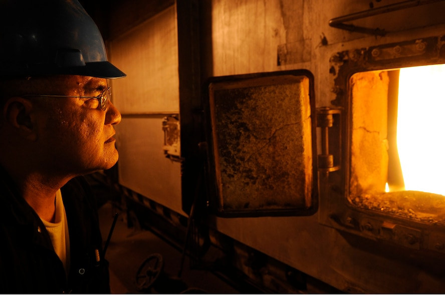 Aumau Aumau, 354th Civil Engineer Squadron fireman, regulates flames at the central heat and power plant Feb. 8, 2012, Eielson Air Force Base, Alaska. Firemen observe and interpret readings on gauges, meters and charts to ensure the boilers are operating properly. (U.S. Air Force photo/Staff Sgt. Jim Araos)