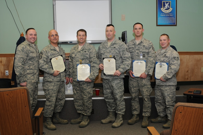 Five members of the 102nd Security Forces Squadron were awarded various medals  during a Feb. 12 awards ceremony at Otis Air National Guard Base, Mass. The medals were awarded for outstanding achievement in direct support of Operations Iraqi Freedom and New Dawn during their deployment to Iraq in 2010. Pictured left to right are Lt. Col. Christopher Hamilton, Command Chief Master Sgt. Wayne Raymondo, Master Sgt. Steven Frietas, Tech. Sgt. Stephen Tibbetts, Staff Sgt. Colin MacEachern and Staff Sgt. James Hightower. (National Guard photo by Tech. Sgt. Kerri Cole/Released)