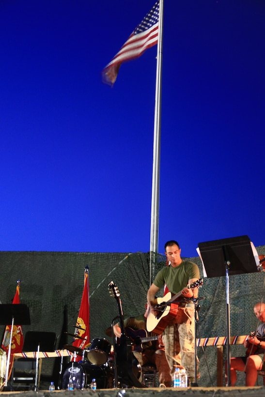 """gt. Sean P. Casaneda, and his band, """"550"""", perform Lynyrd Skynyrd's, """"Simple Kind of Man"""" at the Camp Leatherneck, Helmand province, Afghanistan, Fourth of July celebration.  Casaneda, a native of Cheyenne, Wyo., is an imagery analyst in the Marine reserve, who recently moved to Hollywood, Calif., before deploying to Afghanistan, where he recorded his first music album."""