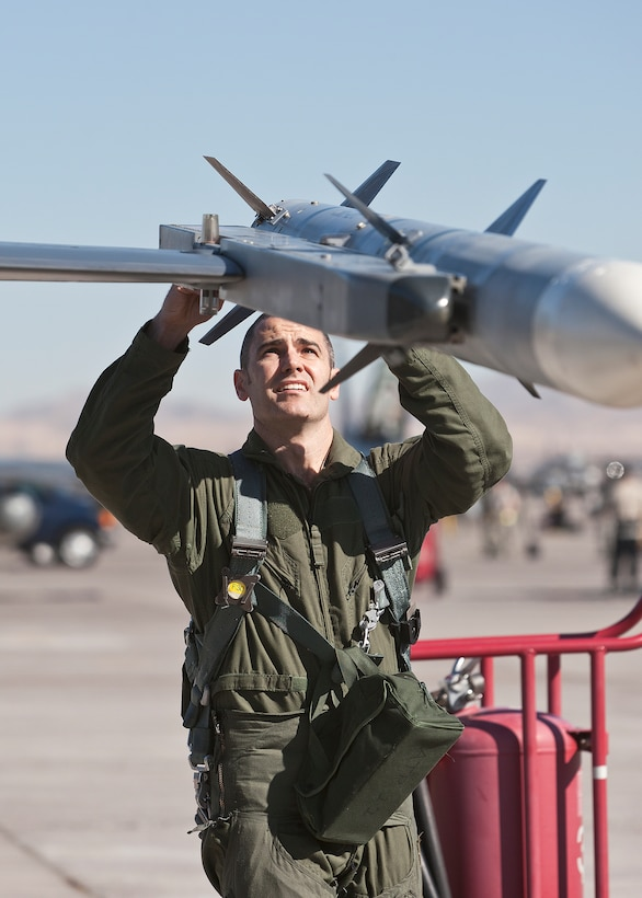Maj. Brian Deas, 416th Flight Test Squadron F-16 test pilot, preflights his jet before joining the day-time war exercise during Red Flag Feb. 1. (Lockheed Martin photo by Chad Bellay)