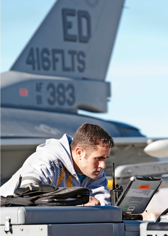 Clinton Minor, 416th Flight Test Squadron maintainer, reads over some training orders before prepping an F-16 for a live weapons release during a Red Flag exercise Jan. 24 at Nellis Air Force Base, Nev. (Lockheed Martin photo by Chad Bellay)
