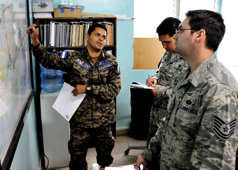 A Honduran Air Force communication technician shows Tech. Sgt. Claudio Winfree and Tech. Sgt. Brian De Luca, 571st Mobility Support Advisory Squadron air advisors, the location of all the FAH communications sites, at Col. Hernán Acosta Mejia Air Base, Tegucigalpa, Honduras, Feb. 7.  The MSAS Airmen, representing 15 Air Force specialties, are working side-by-side with Honduran Air Force members in developing seven core competencies to include air base defense, air traffic control, aircraft maintenance, aircrew survival, communications, generator maintenance and safety.  (U.S. Air Force photo by Tech. Sgt. Lesley Waters)