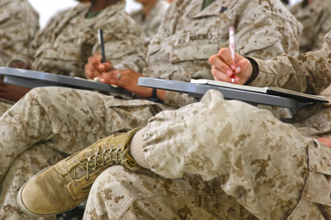 Marines with Female Engagement Team, assigned to Task Force Belleau Wood and utilized as a 2nd Marine Division (Forward) asset, sit during a class while at Camp Leatherneck, Helmand province, for reset training, Nov. 13. Every 45 days the Marines return to Camp Leatherneck from the battalions they are assigned to for training in areas such as Rules of Engagement and tactics for relationship building with the Afghan populace.
