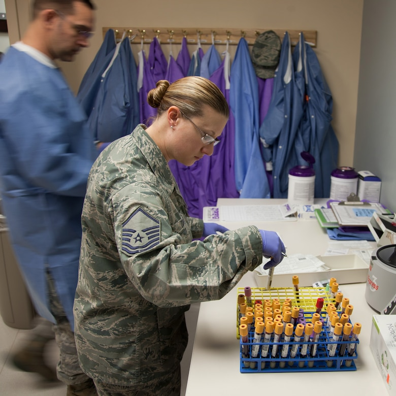 Master Sgt. Sarah Torres, noncommissioned officer in charge of the 349th Aeromedical Medicine Squadron's clinical lab at David Grant USAF Medical Center, quality checks identification on blood-draw containers. Torres is a traditional reservist with the 349th Air Mobility Wing and also a civilian scientist with the 60th Medical Group's Clinical Investigation Facility at DGMC.  (U.S. Air Force photo / Lt. Col. Robert Couse-Baker)