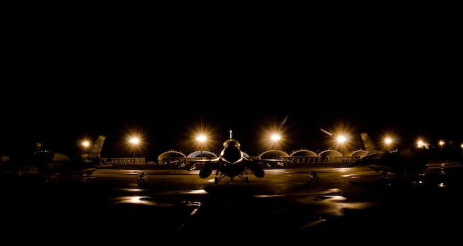 ERSEN AIR FORCE BASE, Guam - F-16 Aircraft from 18th Aggressor Squadron, Eielson Air Force Base, Alaska are parked in the early morning during Cope North 2012 Feb. 15. The 18 AS is here in support of Cope North 2012, flying as the opposing force to the other aircraft participating in the Exercise. Exercise Cope North 2012, a three-week exercise between the U.S. Air Force, the Japan Air Self Defense Force and the Royal Australian Air Force, began Feb. 11 here bringing more than 1,000 service members to the island. The exercise, which will run through Feb. 24, is designed to enhance air operations and serve as a reminder of the three nations are commitment to preserving peace in the Pacific area of responsibility. (U.S Air Force photo by Staff Sgt. Alexandre Montes)