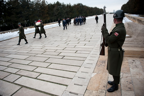 A Turkish service member watches as a U.S. and Turkish military procession passes during a wreath-laying ceremony at Mustafa Kemal Ataturk's memorial and mausoleum Feb. 9, 2012, in Ankara, Turkey. Gen. William M. Fraser III, U.S. Transportation Command commander, travelled to Ankara to participate in the ceremony that honors Ataturk, the founder of the Republic of Turkey.(U.S. Air Force photo by Senior Airman Clayton Lenhardt/Released)