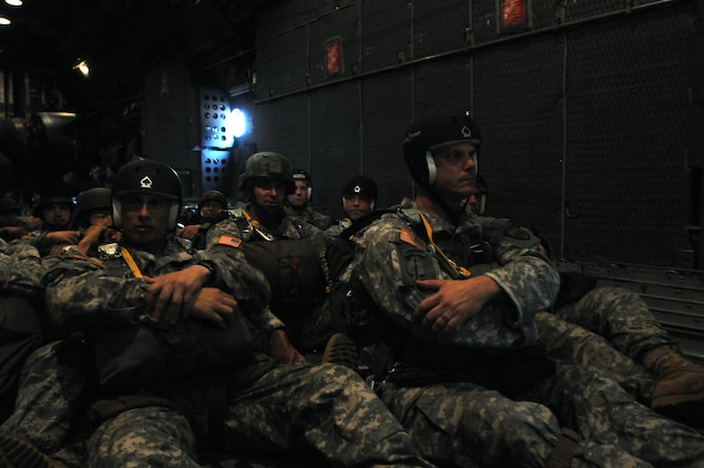 "Members of the U.S. and Royal Thai Army wait to board a C-130 Hercules aircraft prior to take off here Feb. 15. Known as the ""Friendship Jump,"" it has become an annual tradition during Exercise Cobra Gold. Cobra Gold 2012 is the 31st iteration of the joint, multinational exercise held to increase interoperability with participating nations and to advance security throughout the Asia-Pacific region. (U.S Army photo by Pfc. Ryan Scott/released)"