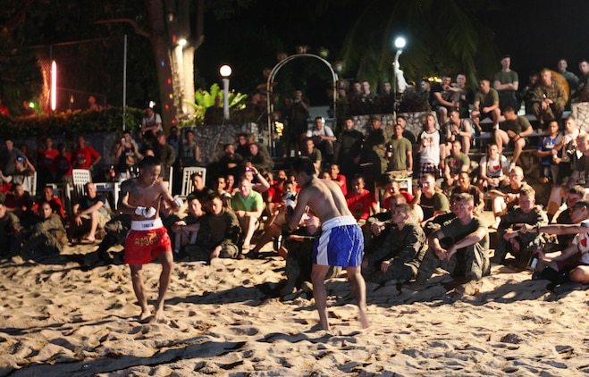 Two Royal Thai Marines conduct a Muay Thai kickboxing demonstration for U.S. Marines and sailors of Company B, Battalion Landing Team 1st Battalion, 4th Marines, 31st Marine Expeditionary Unit, as part of a sports day and warrior dinner celebration of camaraderie on the beach here, Feb. 16. The celebration was held to highlight the successes of the bilateral military forces which participated in Cobra Gold 2012. Cobra Gold 2012 demonstrates the resolve of the U.S. and participating nations to increase interoperability and promote security and peace throughout the Asia-Pacific region. The 31st MEU is the only continuously forward-deployed MEU and remains the U.S.'s force in readiness in the Asia-Pacific region.
