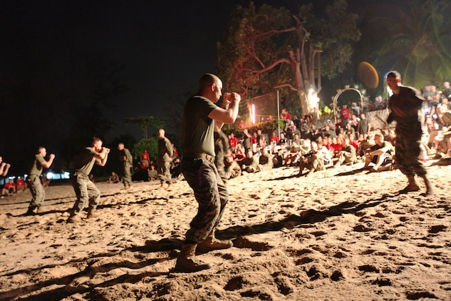 Staff Sgt. James P. Conway, weapons platoon sergeant, Company B, Battalion Landing Team 1st Battalion, 4th Marines, 31st Marine Expeditionary Unit (foreground) prepares to demonstrate the Marine Corps Martial Arts Program to gathered Royal Thai and U.S. Marines, as part of a sports day and warrior dinner celebration of camaraderie on the beach here, Feb. 16. The celebration was held to highlight the successes of the bilateral military forces which participated in Cobra Gold 2012. Cobra Gold 2012 demonstrates the resolve of the U.S. and participating nations to increase interoperability and promote security and peace throughout the Asia-Pacific region. The 31st MEU is the only continuously forward-deployed MEU and remains the U.S.'s force in readiness in the Asia-Pacific region.