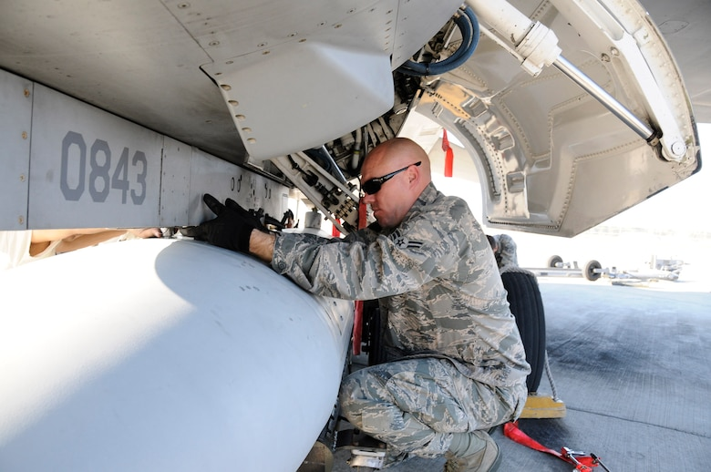Airman 1st Class David Hutchason, an F-16 crew chief with the 144th Maintenance Group, California Air National Guard, prepares to remove an access panel on the F-16 Fighting Falcon after its afternoon mission on February 5, 2012.  (Air National Guard photo by Tech. Sgt. Charles Vaughn)
