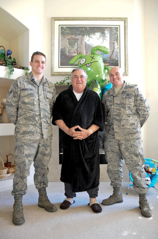 Airmen 1st Class David Hutchason and Tod Miley, both members of the 144th Maintenance Group, California Air National Guard, stand beside retired Chief Master Sgt. Lawrence Pollastrini (center) on Feb. 5, 2012.  Their meeting comes one week after Chief Pollastrini suffered a heart attack and Airmen Hutchason and Miley saved his life by administering CPR.  (Air National Guard photo by Tech. Sgt. Charles Vaughn)