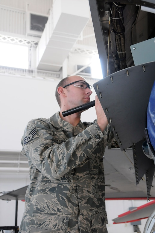 Staff Sgt. Scott Calhoun, an avionics specialist with the 144th Maintenance Group, California Air National Guard, troubleshoots the F-16 Fighting Falcon electronics on January 13, 2012.  (Air National Guard photo by Tech. Sgt. Charles Vaughn)