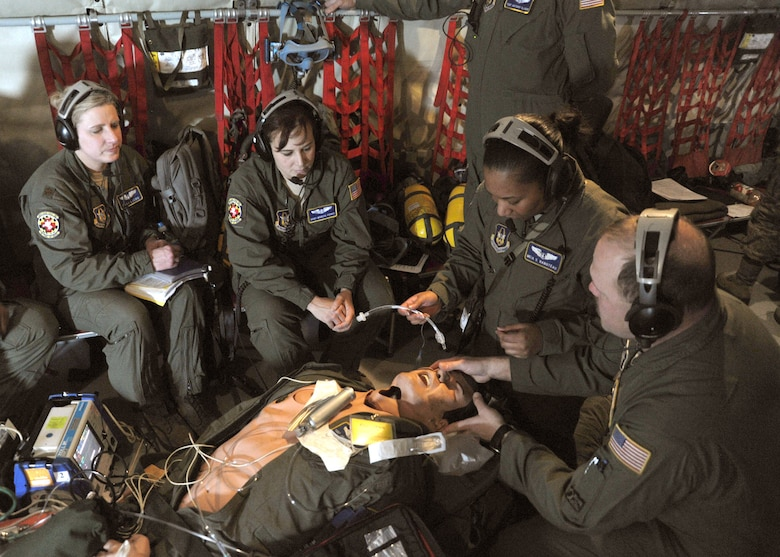 Capt. Meia Rabotaeu, 459th Aeromedical Squadron flight nurse, inserts an uncuffed tracheal tube into a simulated patient during a training exercise aboard a KC-135 Stratotanker high above the Carolinas Feb. 10. The exercise was conducted during an aerial refueling mission. (U.S. Air Force photo/Airman Aaron Stout)