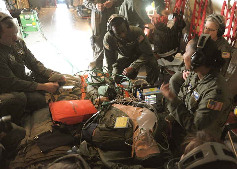 Members of the 459th Aeromedical Squadron treat a simulated patient during a training exercise aboard a KC-135 Stratotanker flying over the Carolinas Feb. 10. The squadron conducts the training about once a week in order to allow every member to maintain their required amount of in-flight hours. (U.S. Air Force photo/Airman Aaron Stout)