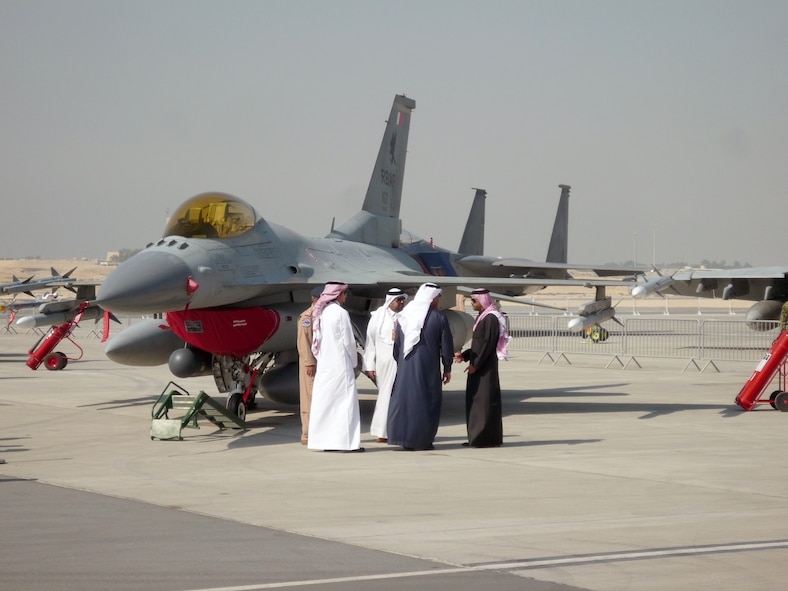 SAKHIR, Bahrain - VIP's tour past an F-16 during the Bahrain International Airshow on January 18, 2012. Airmen from the 106th Security Forces Squadron participated in this years show, meeting with the King of Bahrain and providing security for the visiting U.S. aircraft.