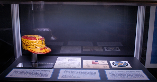 Fatigue hat, blood chit and unit patch worn by Air National Guard members during the Korean War. (U.S. Air Force photo).