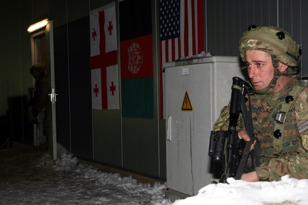 Two Georgian soldiers from the 23rd Light Infantry Battalion keep a watchful eye on the surrounding area after a car bomb detonates at the gates of the unit's Forward Operating Base (FOB) at a mission rehearsal exercise at Joint Multinational Readiness Center Hohenfels, Germany, Feb. 16.