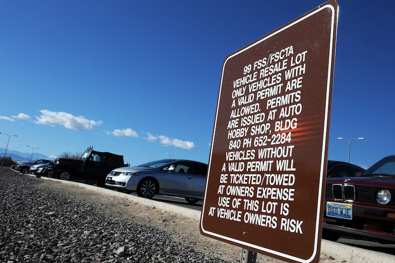 Nellis Air Force Base Resale lot signs advise motorist, vehicles parked in the lot without the proper permit may be towed at the owners expense. Parking lots on base are intended for daily-use by workers and guests, but some vehicles have been left for extended periods of time causing a parking issue. (U.S. Air Force photo by Senior Airman Jack Sanders)