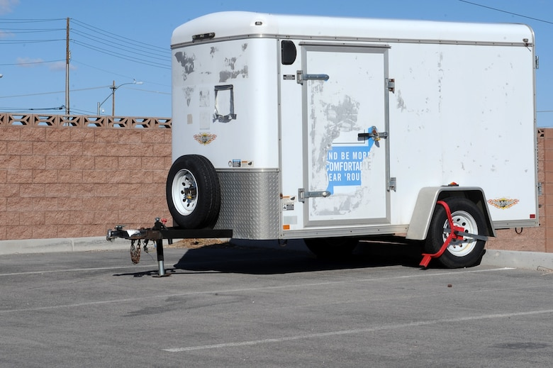 99th Security Forces Squadron booted this trailer, which is seen parked in a unauthorized parking space here Feb. 16th, 2012 at Nellis Air Force Base, Nev. Security Forces will tow (at the owner's expense), impound, and possibly dispose of any vehicles or recreational equipment that are improperly parked or abandoned. (U.S. Air Force photo by Senior Airman Jack Sanders)