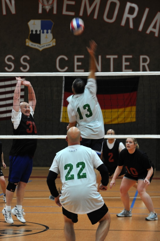 SPANGDAHLEM AIR BASE, Germany – Steven Wilson, 52nd Force Support Squadron, number 30, goes up to block a volleyball spiked by Jose Becerra, 606th Air Control Squadron, number 13, during an intramural volleyball game at the Skelton Memorial Fitness Center here Feb. 15. FSS defeated ACS in two sets, 25-16 and 26-24.  This match kicked off the intramural volleyball season, and games will be played Monday – Thursday beginning at 6:30 p.m. at the fitness center. (U.S. Air Force photo by Airman 1st Class Matthew B. Fredericks/Released)