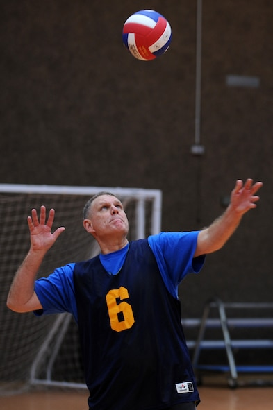 SPANGDAHLEM AIR BASE, Germany – Dennis Wilson, 606th Air Control Squadron, serves the volleyball during an intramural volleyball game against the 606th Air Control Squadron at the Skelton Memorial Fitness Center here Feb. 15. FSS defeated ACS in two sets, 25-16 and 26-24.  This match kicked off the intramural volleyball season, and games will be played Monday – Thursday beginning at 6:30 p.m. at the fitness center. (U.S. Air Force photo by Airman 1st Class Matthew B. Fredericks/Released)