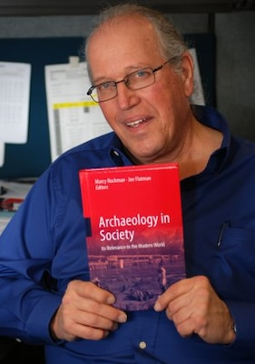"SACRAMENTO, Calif. — Richard Perry, archaeologist with the U.S. Army Corps of Engineers Sacramento District, poses here, Feb. 15, 2012 with the recently published book, ""Archaeology in Society"". Perry's study of prehistoric and historic sites at a former target range at Honey Lake, Calif., is featured in the book."