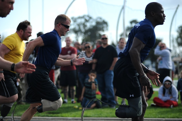 Capt. Jonathan Disbro (left) and Cpl. Kionte Storey (right) sprint down the track for the 2012 Marine Corps Trials 100 meter dash in Camp Pendleton, Calif., Feb. 19, 2012. Storey finished first, earning the gold medal and Disbro second, earning the silver. Both Marines were selected to join the 2012 All-Marine Warrior Games team and will compete in Colorado Springs, Colo. April 30 – May 6.