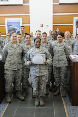 Tech. Sgt. Sharnta Bullard, 36th Medical Operations Squadron, non commissioned officer in charge  ambulance services ,was awarded Team Andersen's Best here, Feb. 9. Andersen's Best is a recognition program which highlights a top performer from the 36th Wing. Each week, supervisors nominate a member of their team for outstanding performance and the wing commander presents the selected Airman/Civilian with an award. (U.S. Air Force photo by Staff Sgt. Alexandre Montes)