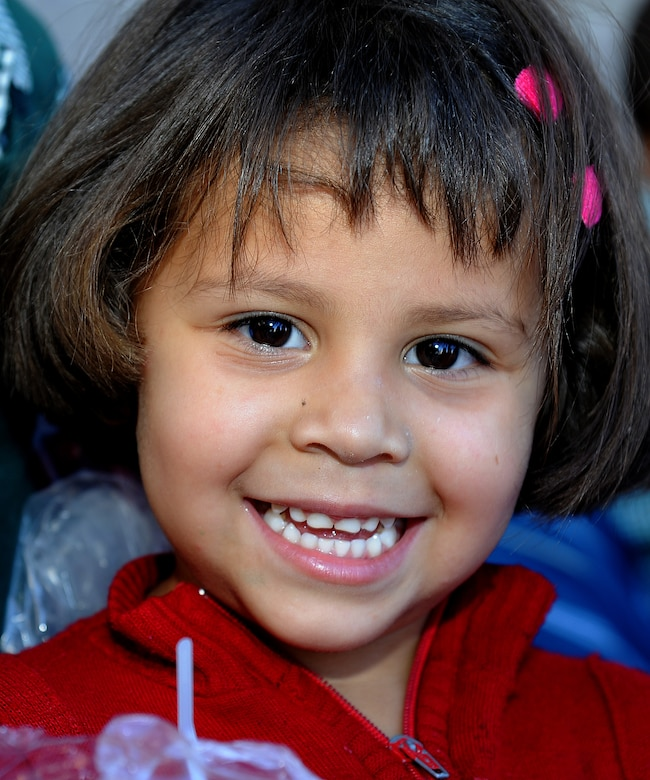 A girl from the Instituto Evangélico El Verbo shows her smile after receiving some new clothes from the Honduran Air Force, Feb. 17.  Instituto Evangélico El Verbo is sponsored by Stewardship of Christian Ministries, which is a non-governmental Christian organization that promotes the development for some of the less fortunate families in Nueva Suyapa community.  (U.S. Air Force photo by Tech. Sgt. Lesley Waters)