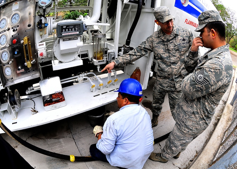 Master Sgt. Michael Raffa, 571st Mobility Support Advisory Squadron fuels air advisor, explains to Tech. Sgt. Filiberto Rodriguez, 571 MSAS fuels air advisor, which valves are used for testing and those used for fuel recirculation during the fuel sample process, in Tegucigalpa, Honduras, Feb. 13.  The MSAS Airmen are participating in a mutually beneficial forum for the exchange of ideas between U.S. and Honduran Airmen via interactive classroom sessions and hands-on training at the base and surrounding areas.  (U.S. Air Force photo by Tech. Sgt. Lesley Waters)