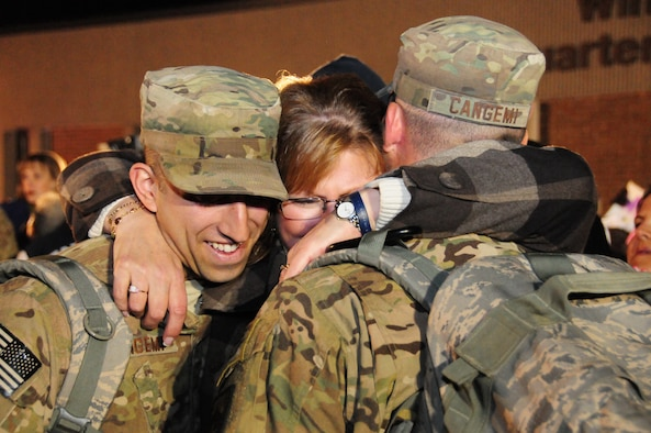 Mary Blodgett (center) embraces her sons Nick (right) and Chris (left) upon their return to Bradley Air National Guard Base in East Granby, Conn. from Afghanistan Feb. 20, 2012. The brothers are both Senior Airmen assigned to the 103rd Civil Engineer Squadron and had been deployed since July 2011 with the Expeditionary Prime Base Engineer Emergency Force (BEEF) squadron, performing light construction and facility repair operations including plumbing, interior electric, HVAC, power production and distribution, as well as other engineering tasks.. (U.S. Air Force photos by Tech. Sgt. Erin McNamara\RELEASED)