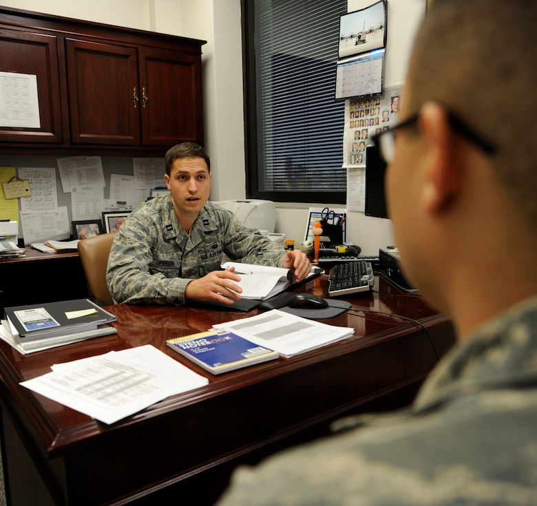 WHITEMAN AIR FORCE BASE, Mo. -- Capt. Michael Pierson, 509th Bomb Wing staff judge advocate chief of military justice, advises an Airman about his issues here Feb. 3. Military justice handles a wide variety of legal issues in real-world experience in the practice of law. The legal issues they encounter are wide-ranging, including criminal, government contract, labor, international, environment and real property laws. (U.S. Air Force photo by Staff Sgt. Alexandra M. Boutte) (RELEASED)