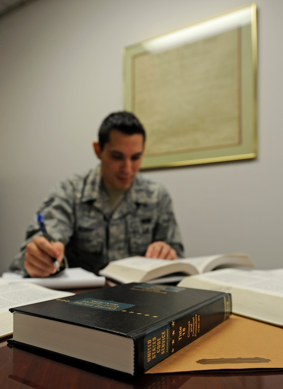 WHITEMAN AIR FORCE BASE, Mo. -- Senior Airman Brett Berry, 509th Bomb Wing staff judge advocate paralegal, researches information for an upcoming trial here Feb. 3.  Paralegals perform the underlying work ranging from conducting research to investigating accidents and ensuring a trial is done properly and developing a reprimand. (U.S. Air Force photo by Staff Sgt. Alexandra M. Boutte) (RELEASED)