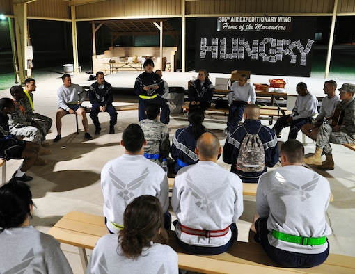 """Senior Airman Heather Parcasio, a 386th Expeditionary Logistics Readiness Squadron planner, leads the first meeting of the Hungry ministry at an undisclosed location, Southwest Asia, Feb. 9, 2012.  Hungry is for young adults who want something different, something geared toward a young adult's interests and needs in Christianity, geared toward military and civilian personnel from 18-29 years of age. Parcasio, a Salinas, Calif., native deployed from the 349th Logistics Readiness Squadron at Travis Air Force Base, Calif., volunteered to lead the new ministry to let young adults know that having faith and following God is always """"cool."""" (U.S. Air Force photo/Tech. Sgt. Stacy Fowler)"""