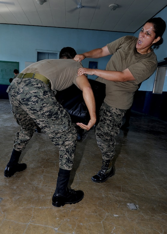 Sergeant 1st Class Carla Moncada, Honduran Air Force security forces member, practices knee strikes as part of the self-protection portion of the air base defense seminar Feb. 14, during the Air Mobility Command Building Partner Capacity mission in Tegucigalpa, Honduras.  (U.S. Air Force photo by Tech. Sgt. Lesley Waters)
