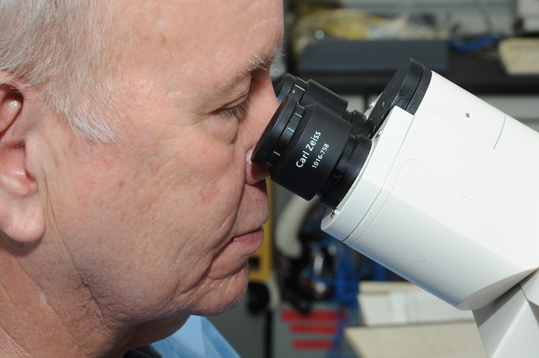 Chris Williams, 81st Medical Operations Squadron cytogenetics technologist, views metaphase under a microscope and logs his findings at the 81st Medical Group's genetics center at Keesler Air Force Base, Miss., Feb. 17, 2012.  (U.S. Air Force photo by Kemberly Groue)