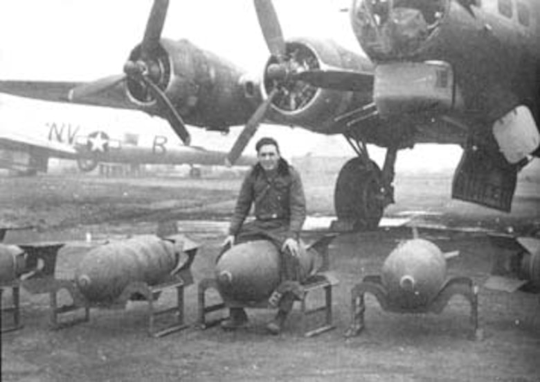 A 92nd Bombardment Group B-17 bomb loader straddles one of his bombs on the flightline in England in the early 1940s (Courtesy photo)
