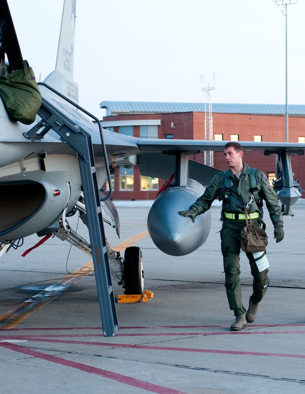 SIOUX FALLS, S.D. - As dusk sets over Joe Foss Field, S.D., 1st Lt. Aaron Werner, 175th Fighter Squadron pilot, makes his final checks on his F-16 aircraft prior to launch here Feb. 16.  The South Dakota Air National Guard does night flying about once a month for a week in order to stay proficient with nighttime operations.(National Guard photo by Senior Master Sgt. Nancy Ausland)(Released)
