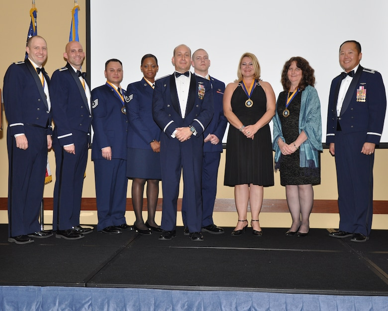 """Col. Mustafa Koprucu, commander of the 505th Command and Control Wing, center, poses with award winners during the 505th CCW's annual awards ceremony at Hurlburt Field, Fla., Feb. 10, 2012.  The theme of this year's banquet was """"A Commitment to Airmen."""" (Courtesy photo)"""