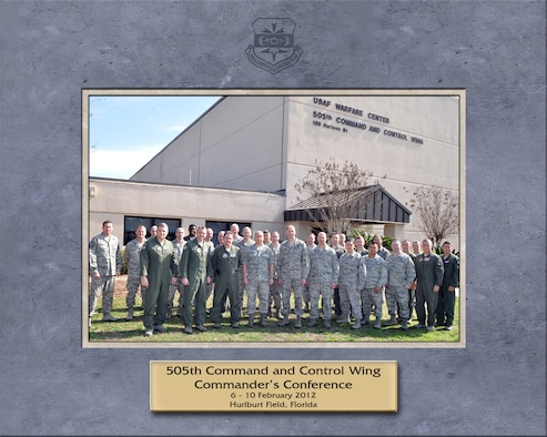 """Col. Mustafa Koprucu, commander of the 505th Command and Control Wing, fourth from left, poses with attendees of the 505th CCW Commander's Conference at wing headquarters in Hurlburt Field, Fla., Feb. 6-10, 2012.  The conference focused on """"Mission and People."""" (Courtesy photo)"""
