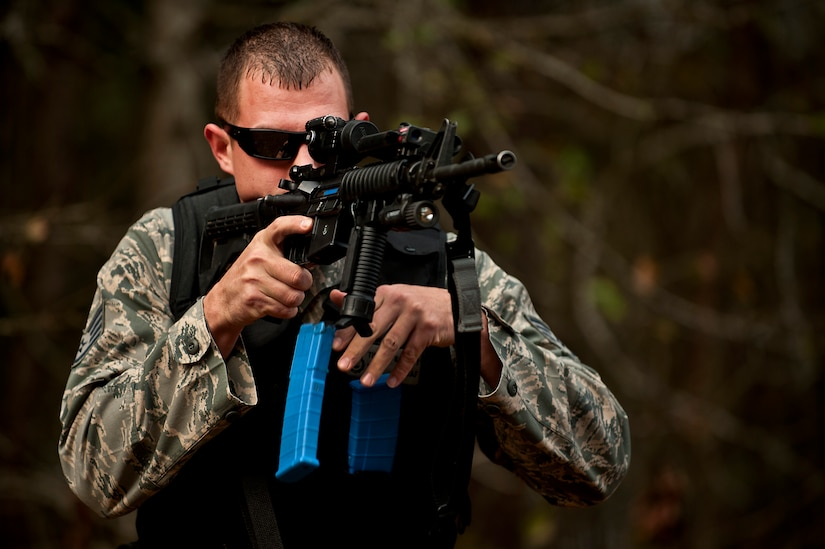 """Staff Sgt. Timothy Garrett practices reloading drills with his M4A1 during a """"Shoot, Move, Communicate"""" training course at the Combat Arms Training and Maintenance range at Joint Base Charleston - Air Base Feb. 16. The training teaches Airmen to react to a hostile shooter by using cover and effective communication to maneuver and engage the target. Garrett is a 628th Security Forces Squadron K-9 handler at JB Charleston - Air Base. (U.S. Air Force photo by Airman 1st Class George Goslin)"""