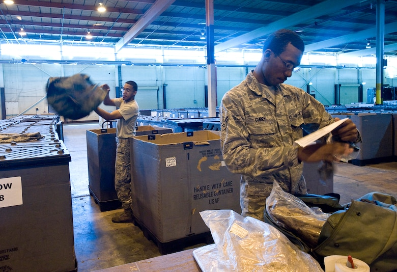 Airmen 1st Class Stephen Walker (left) and Cameron Curry, 2nd Logistics Readiness Squadron, inventory chemical warfare bags to ensure no components expire within the next year in the supply warehouse on Barksdale Air Force Base, La., Feb. 23. Supply Airmen ensure Barksdale Airmen have everything they need to perform the mission here and at deployed locations.  (U.S. Air Force photo/Senior Airman Chad Warren)(RELEASED)