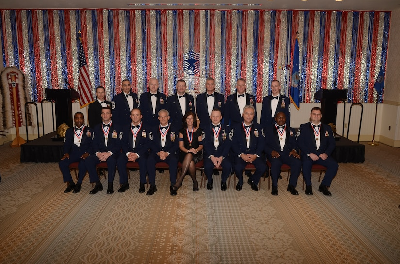 Kathy Knichel sits center stage among Joint Base Charleston's leadership and new chief master sergeants after being named as an honorary chief master sergeant at the Chief's Recognition Ceremony at JB Charleston's - Air Base Club Feb. 4. Knichel is the 628th Air Base Wing protocol officer. (U.S. Air Force photos/Tech. Sgt. Chrissy Best)